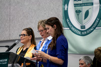 MCC students Tina Ceesay, Vicki Carter and Megan Myhaver recite the student pledge.