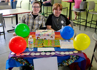 Simone and Riley at the MCC Pride table
