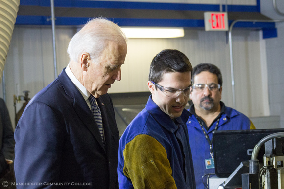 Welding student Riley Brown demonstrates plasma cutting to VP Biden